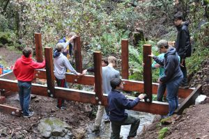 Courtesy of Carl Valdes. Carl Valdes and his friends start to work on the new and improved foot bridge on Mount Tamalpais.