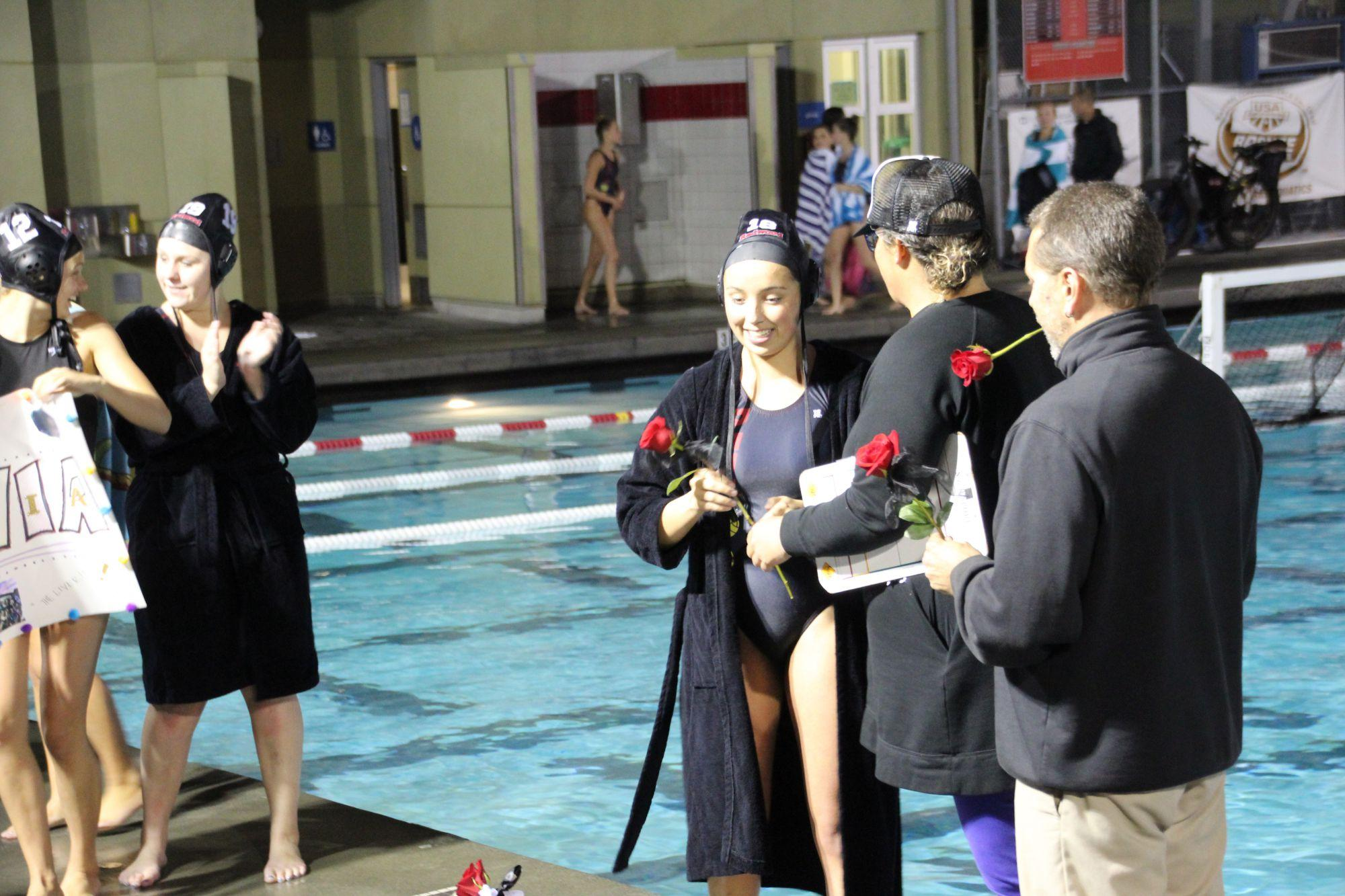 The girls' varsity water polo team blown out of the water in final regular season game