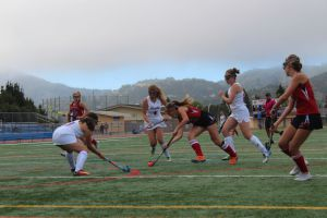 Attacking Tam's goals, Senior Nicole Notter (20) strives past her opponent.