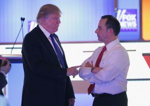 Fully engaged, President Trump talks with former chief of staff, Reince Priebus.