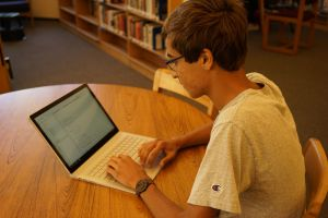 Typing away, senior Austin Patel adds code to his latest artificial intelligence program.