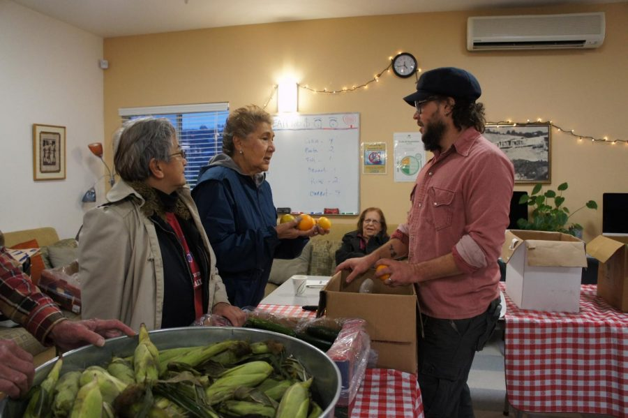 Discussing available produce, volunteers prepare for more customers at the Tiburon location.