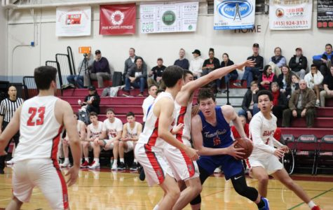 Boys' varsity basketball scores slim victory over Tam