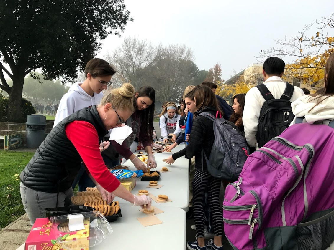 Student's gather around and grab free cookies to help relieve stress before finals
