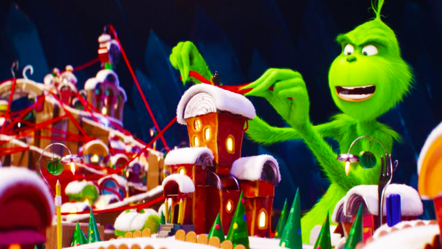 Perusing his model of Whoville, the Grinch (Benedict Cumberbatch) goes over his plan to steal Christmas.