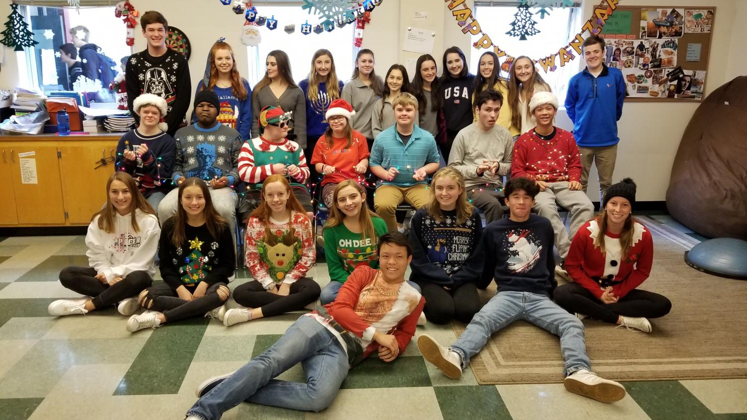 Leadership students, students that help in the Special Education class, and Special Education students pose in their ugly holiday sweaters from Boudin and Ugly Sweater Day on December 7.
