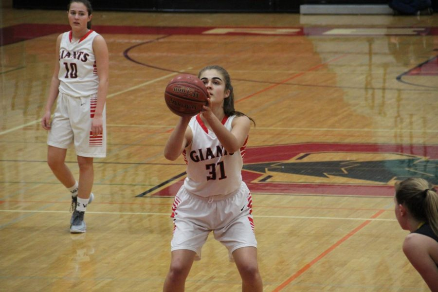 Redwood varsity girls' basketball continue their undefeated MCAL streak in a game against Novato High