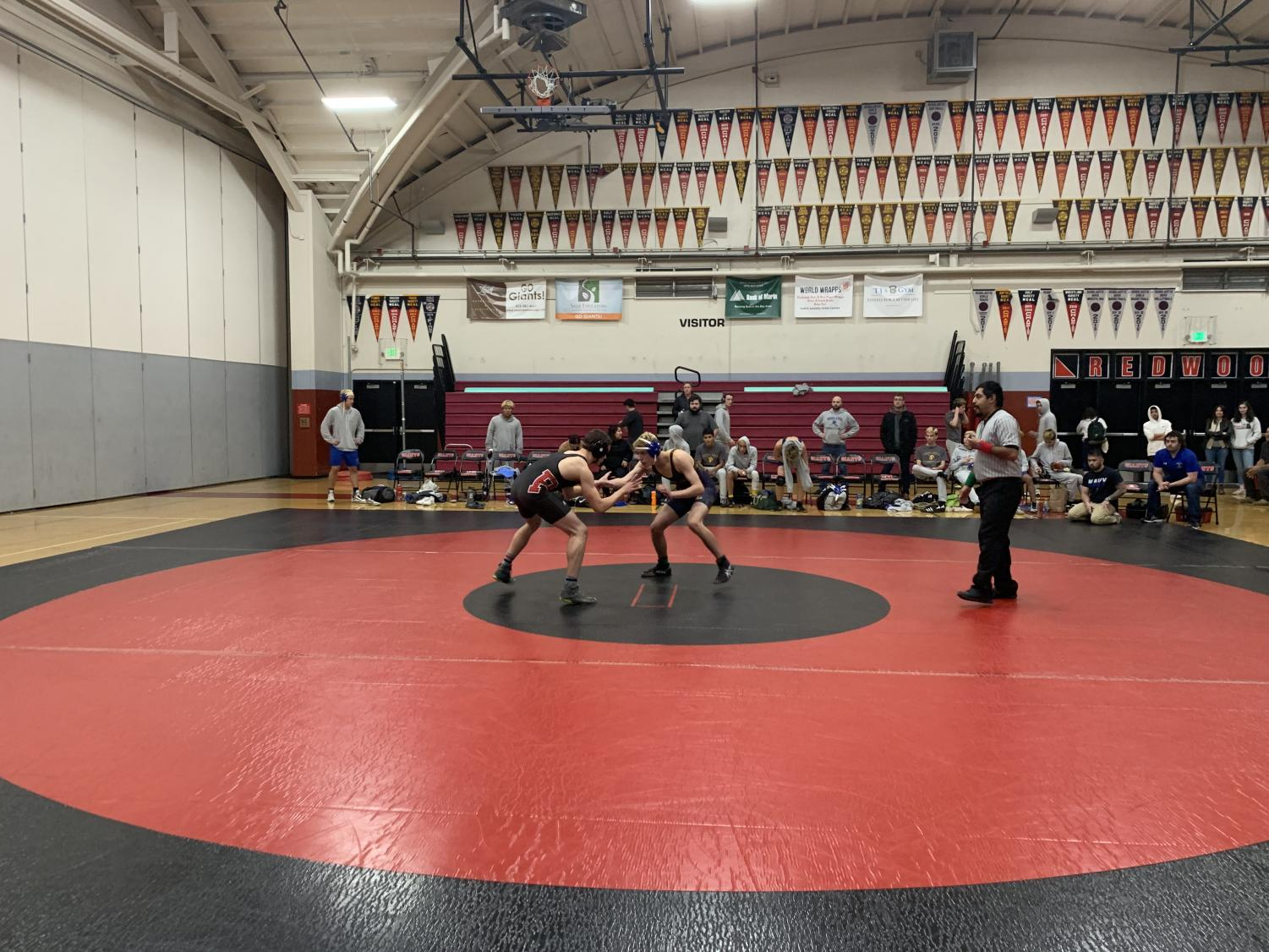Seeking their fifth MCAL game win, Redwood wrestler Michael Acquistapace prepares to engage with his opponent from Terra Linda.