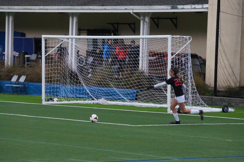 Freshman+goalie+Mia+Hammant+kicks+the+ball+to+her+teammates+and+away+from+the+goal.+