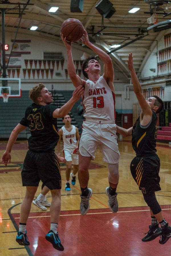 Senior Jake Mathews attacks the basket and helps lead the Giants to a 59-50 victory over the Novato Hornets.