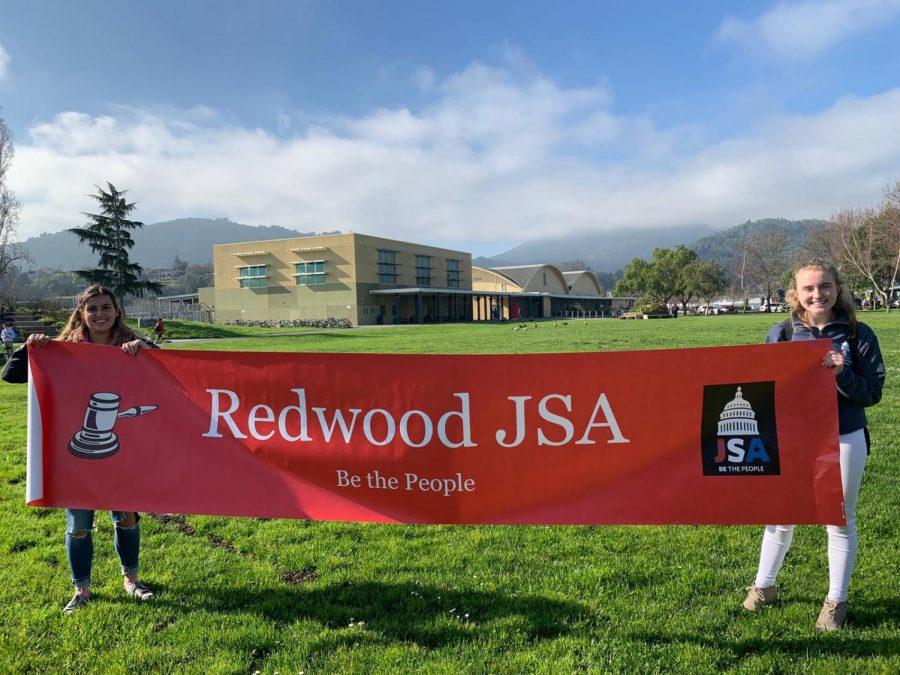 At Club Day, juniors Caitlin Kulperger and Gianna Panzardi promote their club, Junior Statesmen of America.