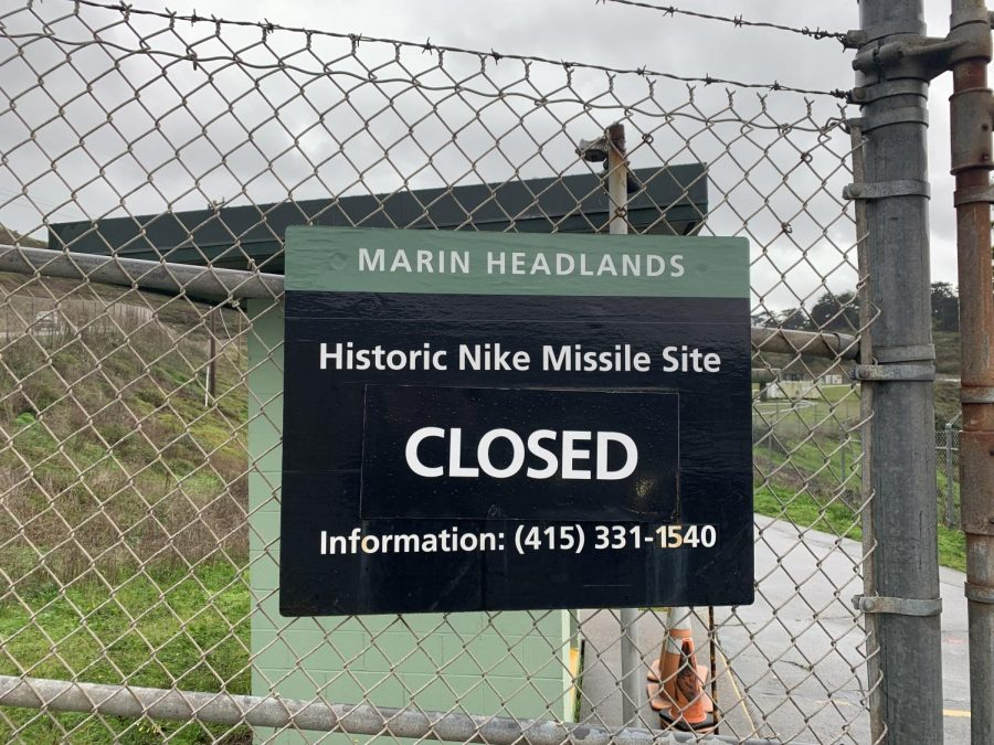 A closed sign blocking entrance to the Nike Missile Site in the Marin Headlands national park.