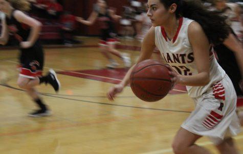 Gabby Beltran pushes the ball towards the basket with a San Rafael defender in tow