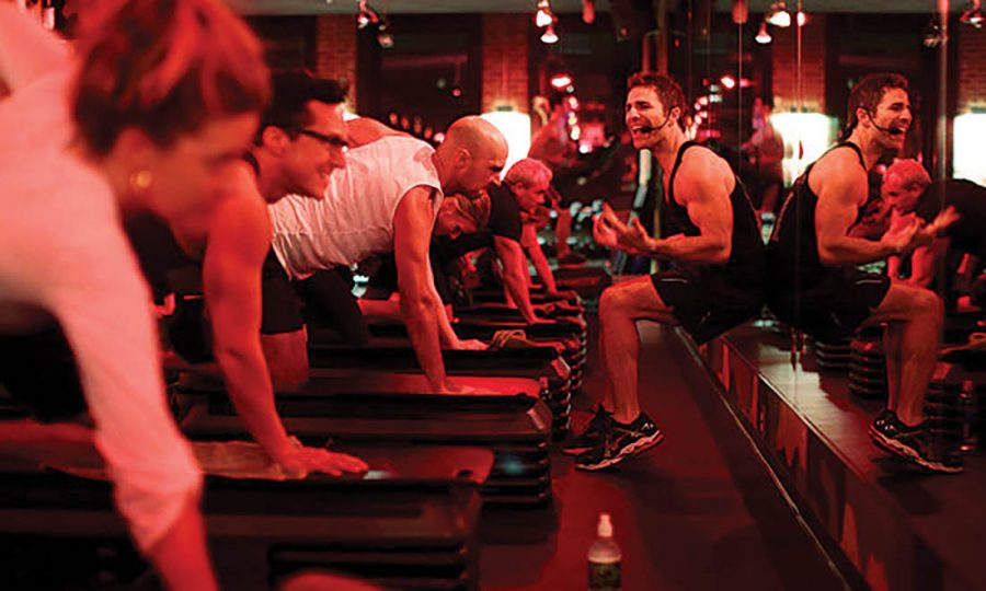 People workout with an instructor at Barry's Bootcamp.