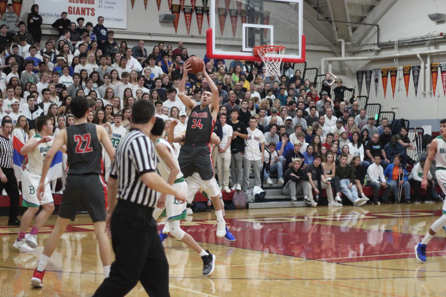 Overcrowding Redwood's Phil Roark gymnasium, over 2,152 people showed up to for the Marin County Athletic League [MCAL] championship basketball game on Feb. 4.