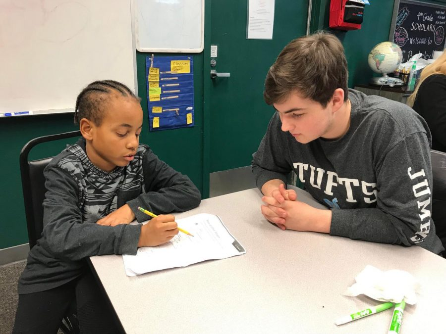 Going over some math problems, junior Jacob Grujic helps a Bridge the Gap student complete his homework.