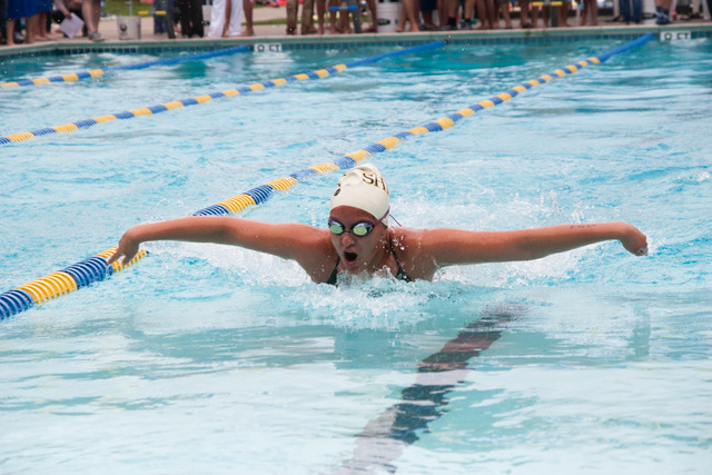 Swimming butterfly in a meet for her old club team, Kallmeyer races her way to the wall.