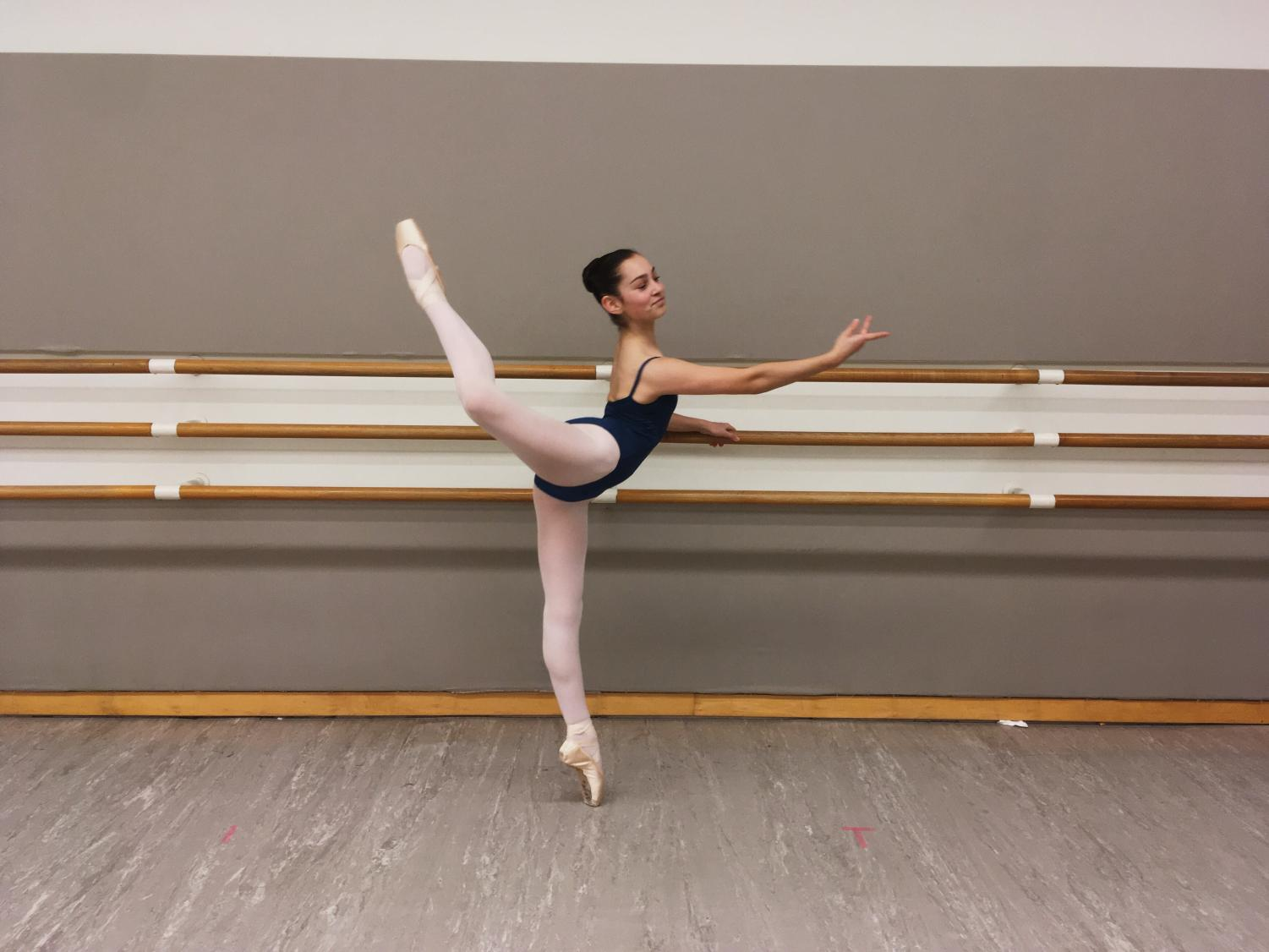 Gracefully refining her technique, Lubinski practices her back attitude at the barre at San Francisco Ballet school, where she takes classes.