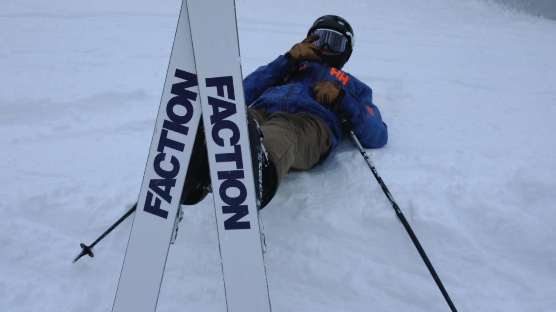 Luke rests on a snowbank after a run