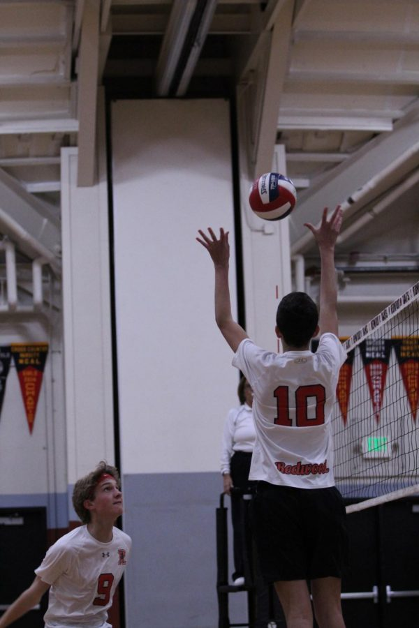 Sophomore Asher Heller (10)  sets ball for  sophomore Lucas Wright (2)