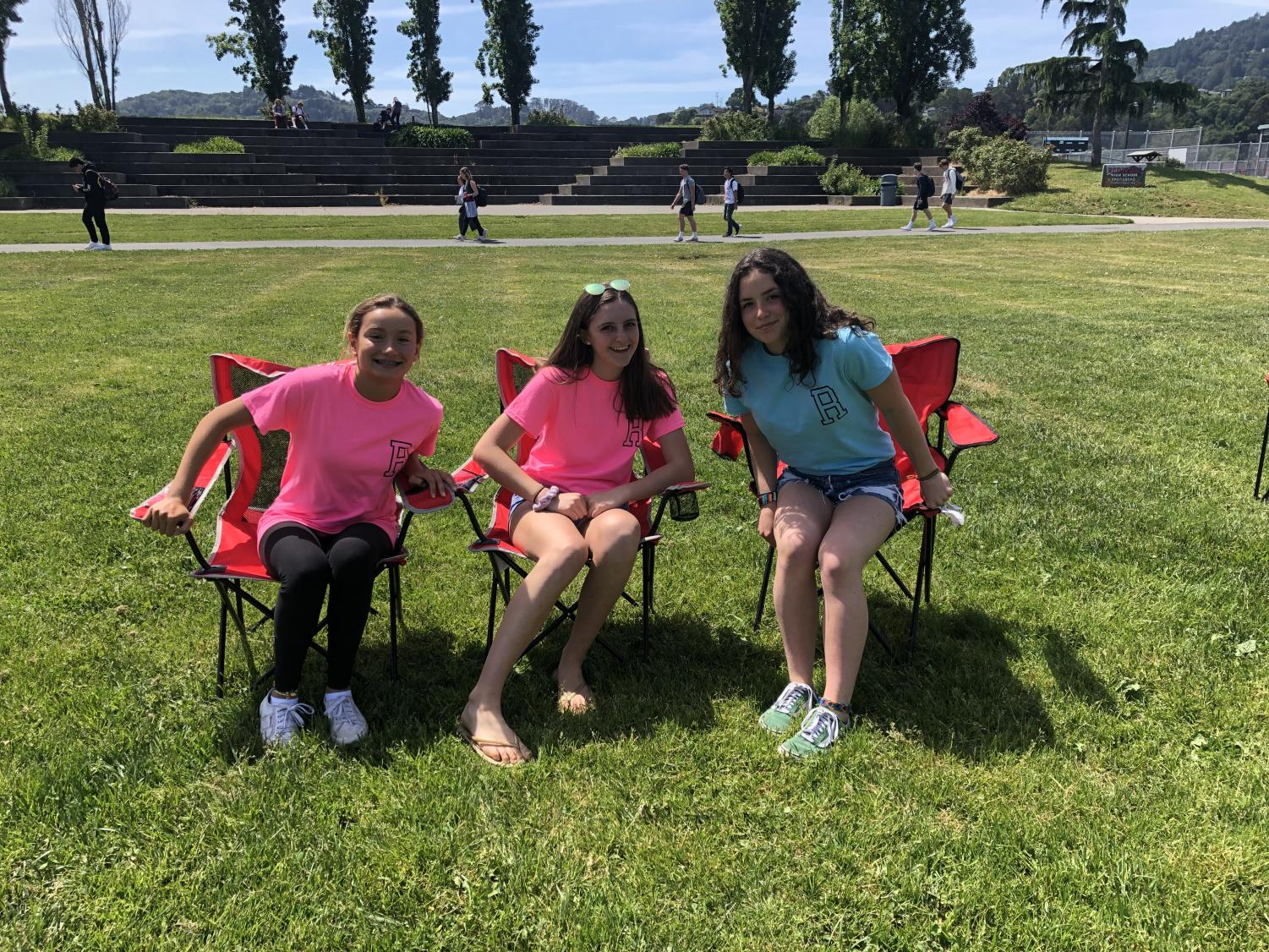 Sitting together in lawn chairs, Leadership students host