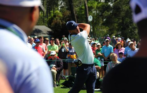 Brooks Koepka tees off of the first hole at The Masters.