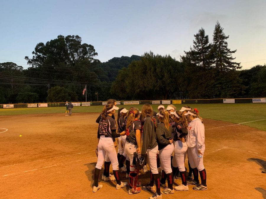 Redwood huddles together after giving up three runs in the fifth inning during a playoff game against San Marin in Novato on Wednesday, May 8, 2019.