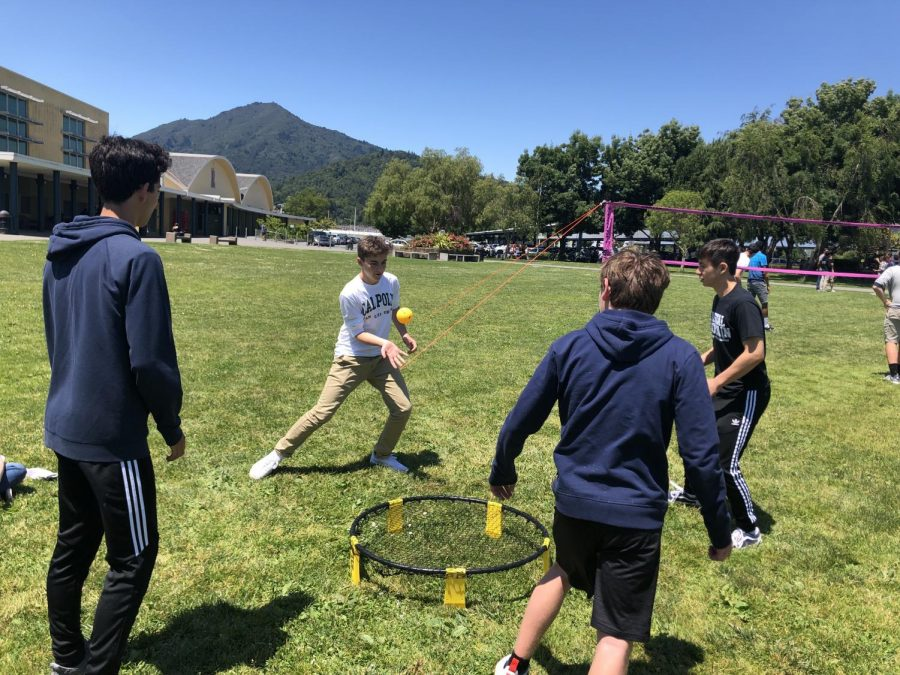 Students play spikeball during the last lawn-chair Friday of the year.
