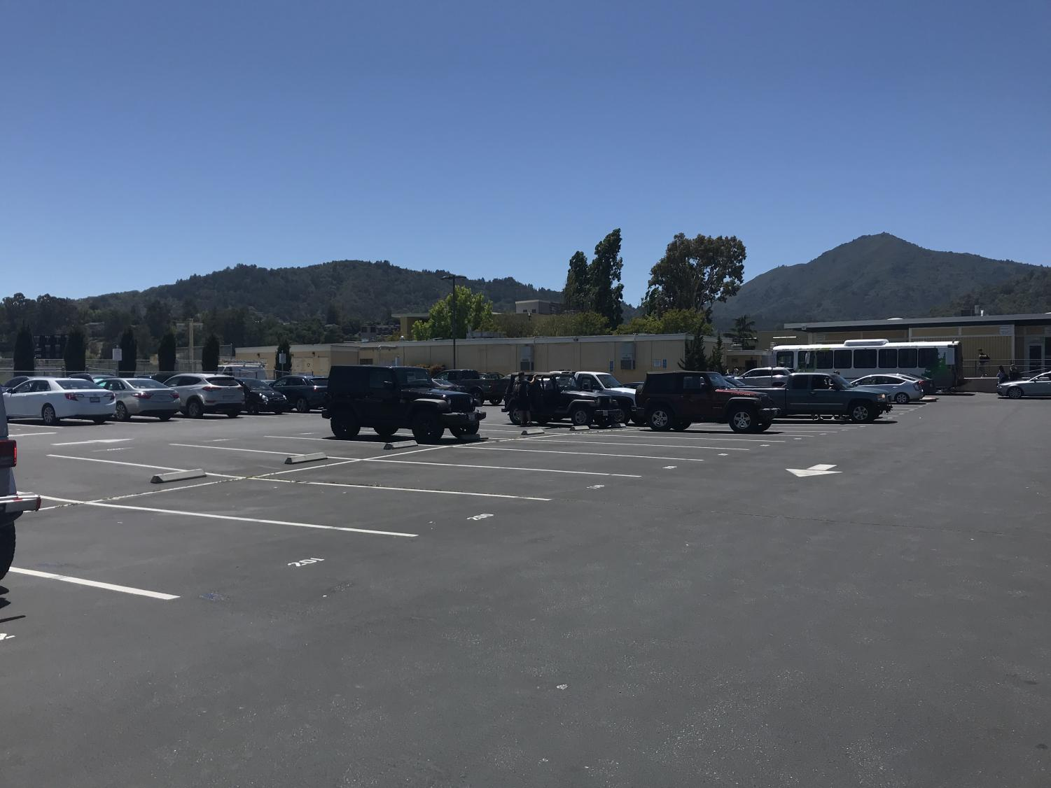 On Tuesday, May 28, the back parking lot was strikingly empty, a feat that can only be attributed to the fact that it was the annual Senior Ditch Day. Instead of attending their regularly scheduled classes, seniors extended their three-day weekend and enjoyed the sunny weather at Stinson, San Francisco, and pretty much any place that wasn't Redwood.