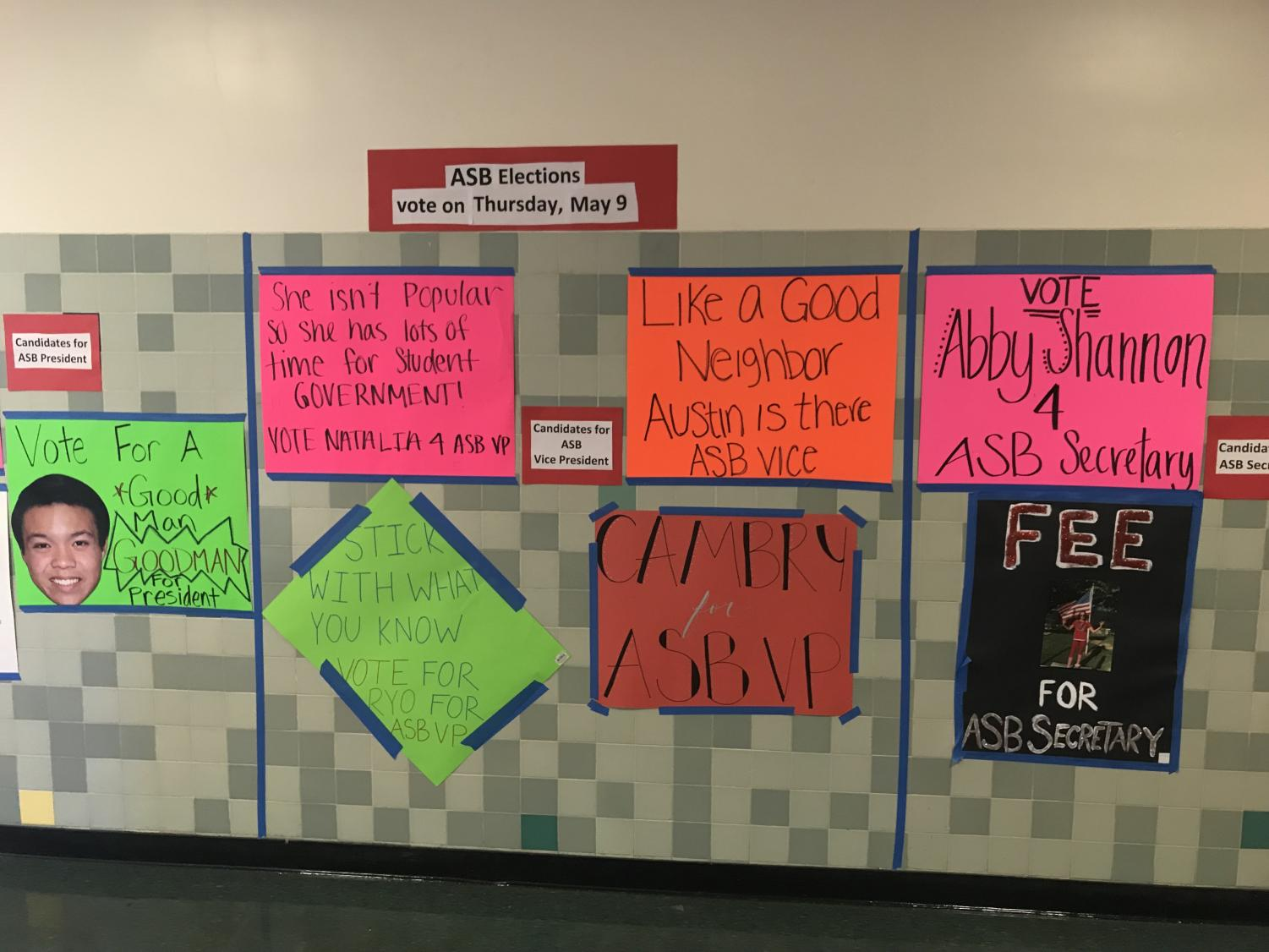 Students put up election posters in the halls for the ASB election this week. Results will be posted at the end of the day on May 10.