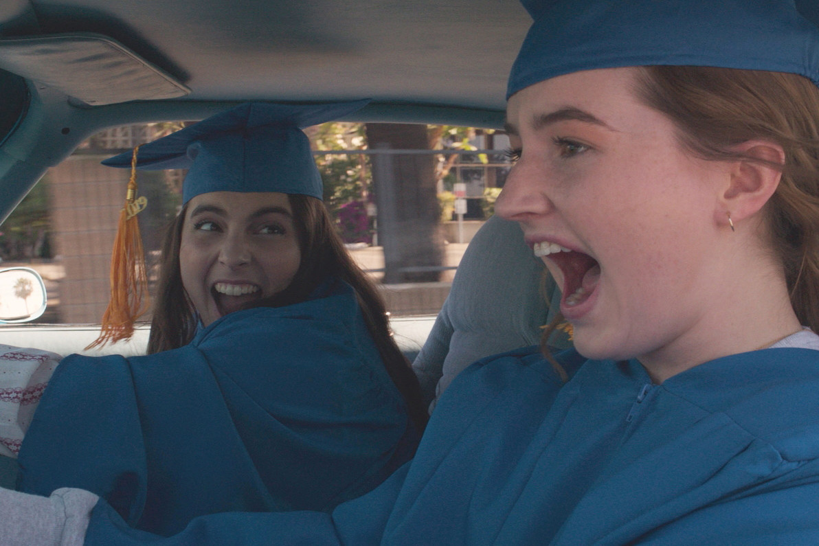 Zooming away, Molly (Beanie Feldstein) and her best friend Amy (Kaitlyn Dever) speed to their last day of graduation in the movie Booksmart directed by Olivia Wilde.