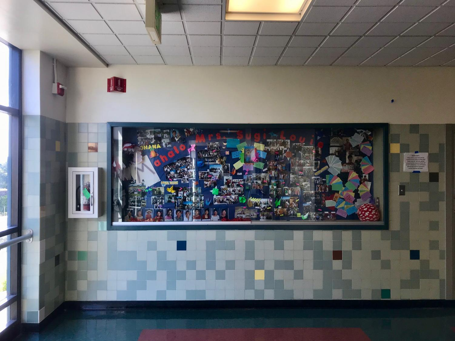 Retiring after many years of teaching math at Redwood, teachers and students decorated the display case to say goodbye to Lovelyn Sugi-Louie.