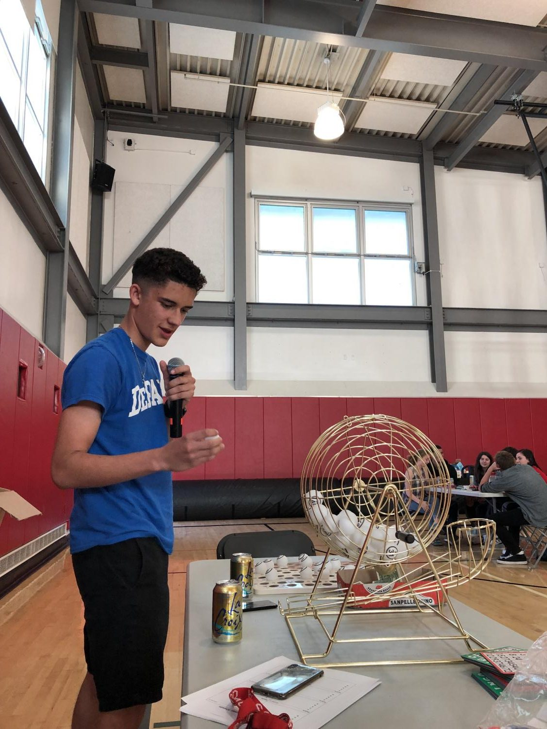 At the second annual trivia night on May 31, sophomore Ryan Barbosa reads out bingo numbers between trivia rounds.