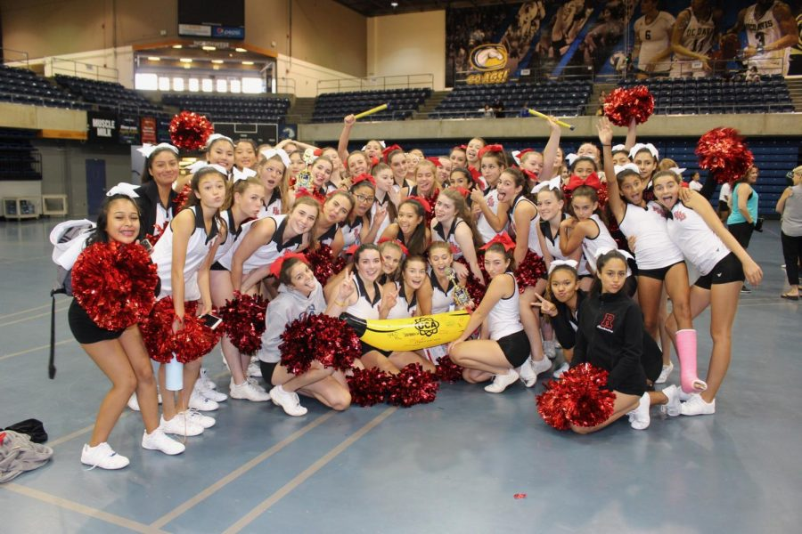 (Courtesy of Shannon McGuinness) Both teams hold up their spirit sticks and bananas.