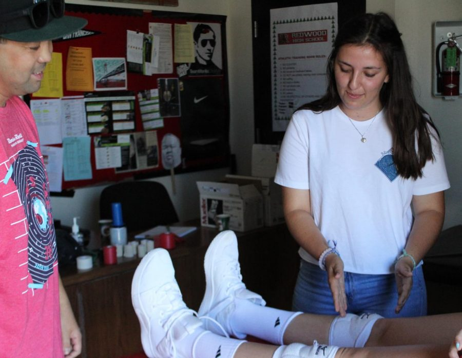 Seniors practice working in sports medicine with athletic trainer