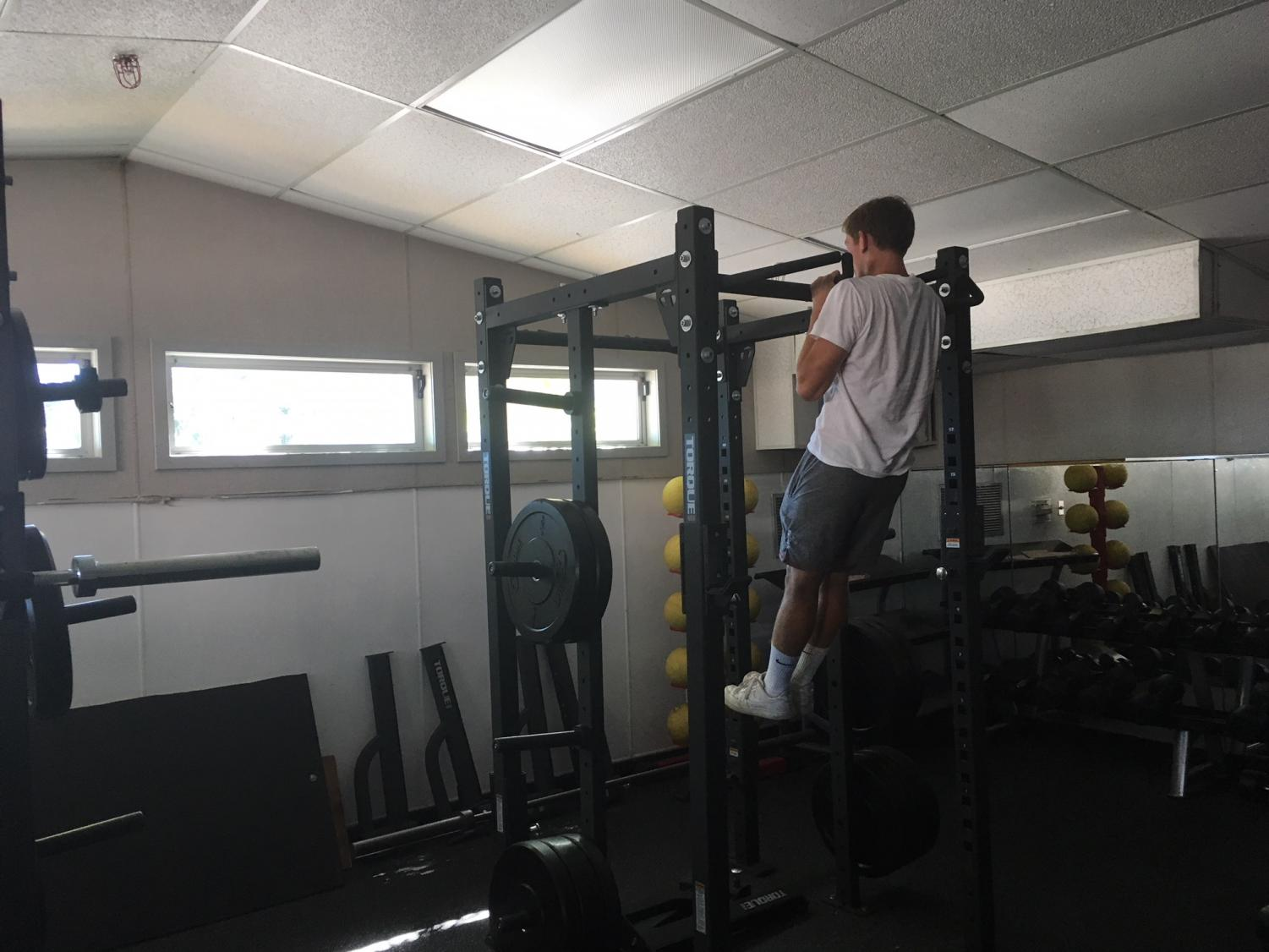 Senior+football+player+Chris+Fuegner+does+a+pull-up+during+an+after+school+workout