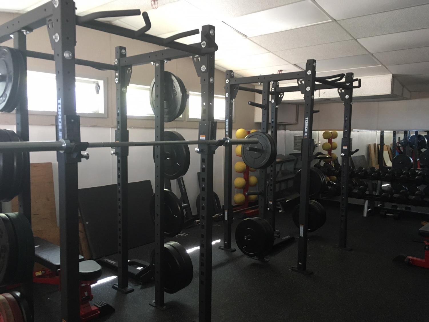 New+black+squat+racks+are+pushed+up+against+the+south+wall