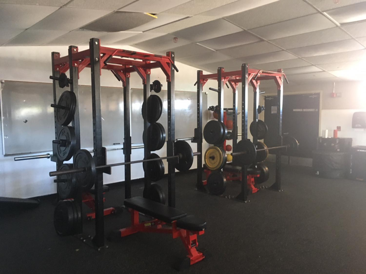 Two+of+the+old+squat+racks+still+remain+but+are+pushed+to+the+north+wall+to+allow+for+more+center+space