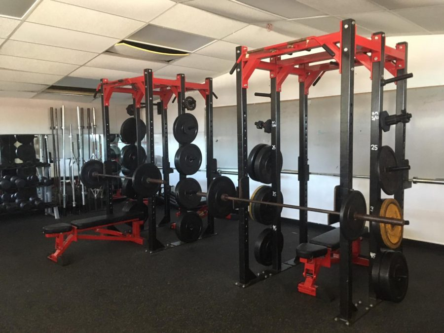 The old racks are prepped for a team workout with a whiteboard designed to help team lifting sessions