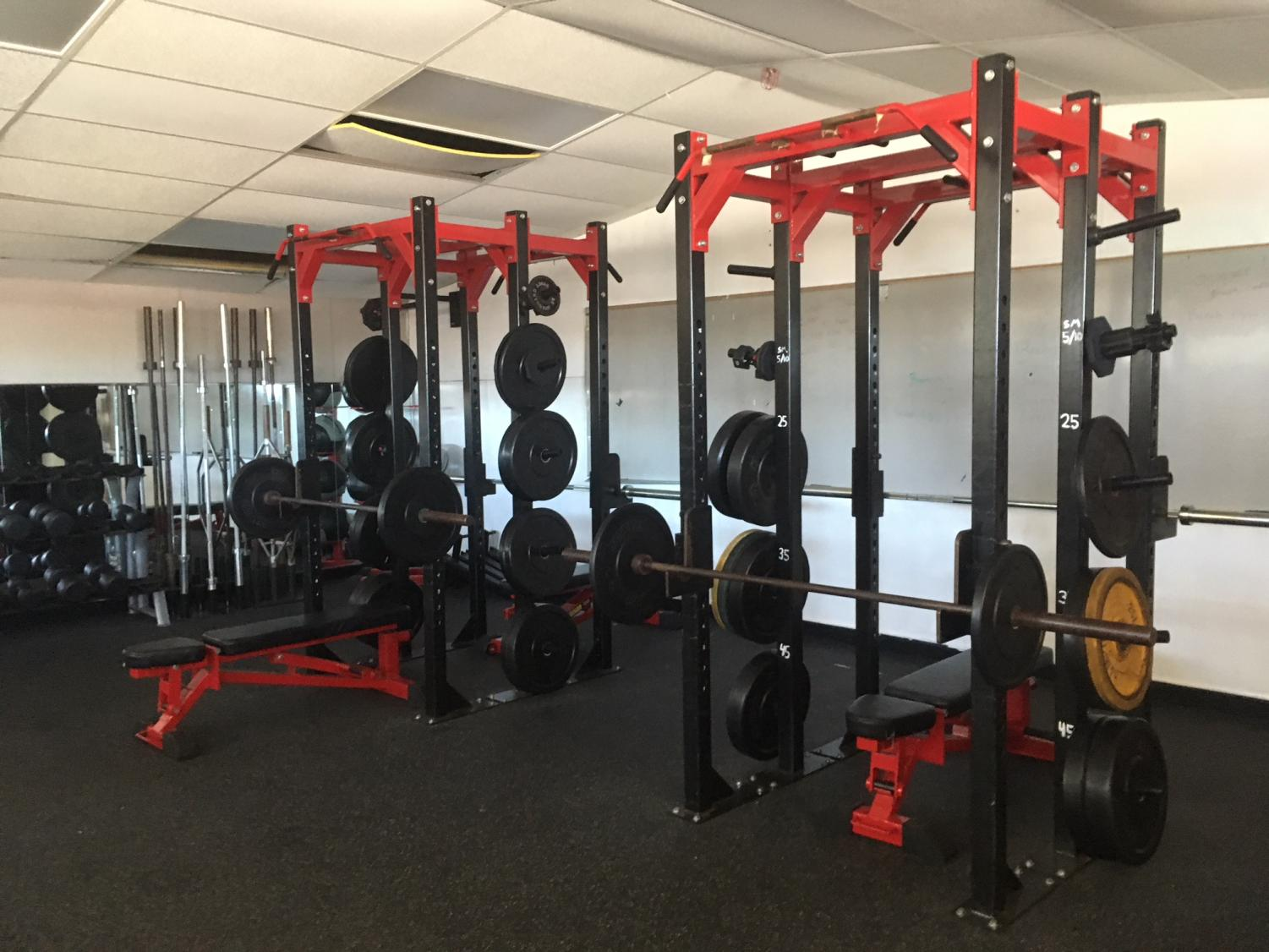 The+old+racks+are+prepped+for+a+team+workout+with+a+whiteboard+designed+to+help+team+lifting+sessions
