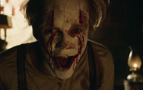 "Playing the infamous Pennywise in ""It: Chapter Two,"" Bill Skarsgärd smiles terrifyingly at the camera."