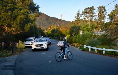 Middle schooler bikes across the busy corner of William from the exit of the Larkspur Corte Madera bike path.