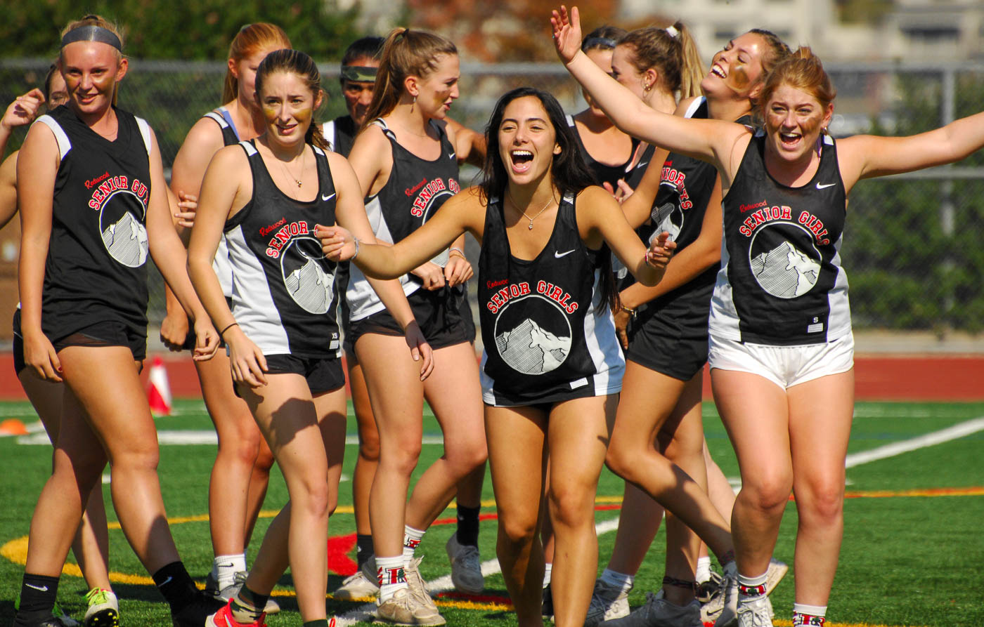 Senior Lily Carbullido and fellow teammates pump up the crowd after the senior girls' first touchdown during Klassy Kickoff.