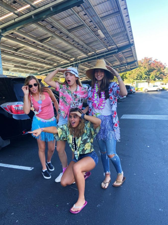Seniors Skylar Strotz, Natalia Siri, Lauren Steele and Gianna Panzardi show school spirit on Tropical Tuesday