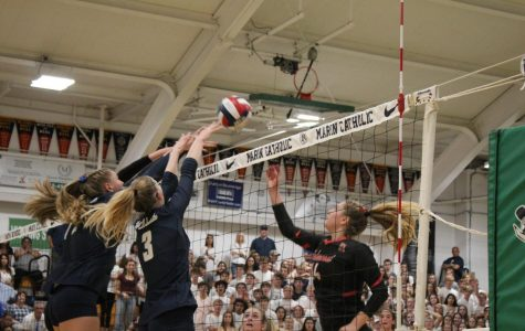 Redwood defender Grace Matthews (right) rises to a challenge from the Marin Catholic offense.