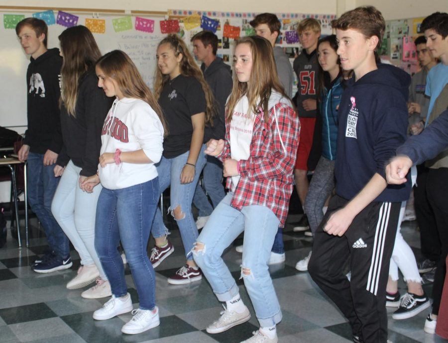 Learning about Caribbean culture, Profe Zeiher's Honors 7-8 Spanish class dances to the merengue.