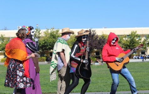 Dancing across the stage for the costume contest, the Spanish department poses as characters from Coco.