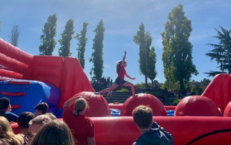 Students take on the obstacle course as Homecoming week festivities continue.