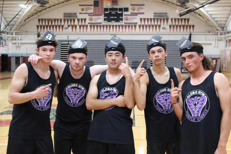 Team Globo Gym poses with their amazon gift cards after winning the eighth annual RNL dodgeball tournament.