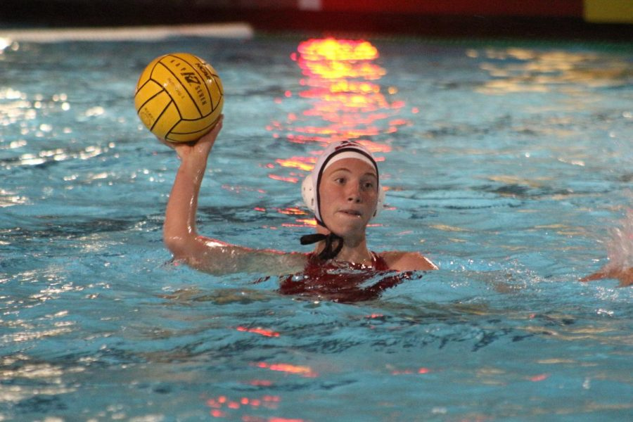 Freshman Adella Frender  throws the ball as she treads water during the Drake v. Redwood match.